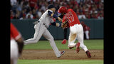 Los Angeles Angels' Shohei Ohtani (17) is tagged out by Houston Astros third baseman Yuli Gurriel on a rundown between second and third base following a ground ball by Justin Upton during the second inning of a baseball game Tuesday, July 16, 2019, in Anaheim, Calif. (AP Photo/Marcio Jose Sanchez)