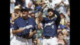 Milwaukee Brewers' Ryan Braun reacts after hitting a triple during the sixth inning of a baseball game against the Atlanta Braves Wednesday, July 17, 2019, in Milwaukee. (AP Photo/Morry Gash)