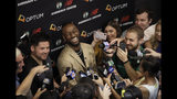 Newly acquired Boston Celtics guard Kemba Walker laughs while surrounded by media at the Celtics' basketball practice facility, Wednesday, July 17, 2019, in Boston. (AP Photo/Elise Amendola)