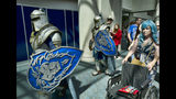 """FILE - In this Thursday, July 19, 2018, file photo, attendees Michael Mijerark, left, and Ryan Trent, center, dress as knights from """"Warcraft,"""" at Comic-Con International in San Diego. The four-day 2019 Comic-Con kicks off Wednesday, July 17, 2019, when the showroom floor opens to thousands vying for exclusive merchandise. (AP Photo/Richard Vogel, File)"""