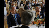 Gouverneur of Bank of England Mark Carney, left, and Gouverneur Bank of Japan Haruhiko Kuroda attend a dinner hosted by the Bank of France in Paris, Tuesday, July 16, 2019. Finance officials from the Group of Seven rich democracies will weigh risks from new digital currencies and debate how to tax U.S. tech companies like Google and Amazon when they meet in the Paris suburb of Chantilly tomorrow. (AP Photo/Michel Euler)