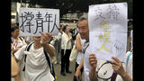 "Elderly Hong Kong residents with posters that read ""Support young people"" during a march in Hong Kong on Wednesday, July 17, 2019. Some 2,000 Hong Kong senior citizens, including a popular actress, marched Wednesday in a show of support for youths at the forefront of monthlong protests against a contentious extradition bill in the semi-autonomous Chinese territory.(AP Photo/Phoebe Lai)"