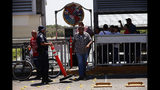 People line up to cross the border into the U.S. on the International Bridge 1, in Nuevo Laredo, Mexico, Tuesday, July 16, 2019. A U.S. policy to make asylum seekers wait in Mexico while their cases wind through clogged U.S. immigration courts has also expanded to the violent city of Nuevo Laredo. (AP Photo/Marco Ugarte)