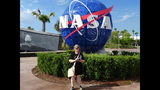 """This 2015 photo provided by June Dorricott of Brisbane, Australia, shows her during a visit to the Kennedy Space Center in Florida. On July 21, 1969, while others were watching in the wee hours of the night or morning, June was spending the afternoon home on an unofficial day off from school: """"I was seven years old and waiting at the bus stop in a little town called Toowoomba, Australia when my mother came up to get me. She told me I didn't have to go to school because a man was going to walk on the moon. Little Judy Wakefield, who was waiting with me, started to cry, and mum told her she had the day off too, so she could go home. I found out much later in life that we didn't actually have off school. I really think she thought it was important that we witness a man make history live on TV. (Courtesy June Dorricott via AP)"""