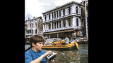 """This August 1969 photo provided by Frank Schramm shows him during a family trip to Venice, Italy. Schramm of Montclair, N.J., was 12 at the time of the Apollo 11 moon landing. But rather than being at home, he was out swimming, hiking and building rockets for four weeks at Camp Watonka in Hawley, Pa. """"I will never forget that evening of all 175 campers and I, watching this small black-and-white TV with Neil Armstrong coming out of the Lunar Module in that very blurry image from the moon. The room was in total awe, you could hear a pin drop. I will never forget this day!"""" (Courtesy Frank Schramm via AP)"""