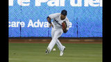Miami Marlins right fielder Cesar Puello fields a ball hit by San Diego Padres' Manny Machado during the first inning a baseball game Wednesday, July 17, 2019, in Miami. (AP Photo/Wilfredo Lee)