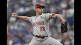Cincinnati Reds starter Anthony DeSclafani delivers a pitch during the first inning of the team's baseball game against the Chicago Cubs on Tuesday, July 16, 2019, in Chicago. (AP Photo/Paul Beaty)