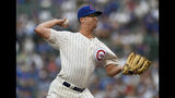 Chicago Cubs starter Alec Mills delivers a pitch during the first inning of the team's baseball game against the Cincinnati Reds on Tuesday, July 16, 2019, in Chicago. (AP Photo/Paul Beaty)