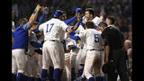 Chicago Cubs' Kyle Schwarber celebrates with teammates at home plate after hitting a solo home run to defeat the Cincinnati Reds 4-3 in the 10th inning of a baseball game Tuesday, July 16, 2019, in Chicago. (AP Photo/Paul Beaty)