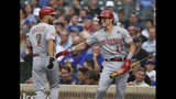 Cincinnati Reds' Eugenio Suarez (7) celebrates with Derek Dietrich (22) after hitting a solo home run during the first inning of the team's baseball game against the Chicago Cubs on Tuesday, July 16, 2019, in Chicago. (AP Photo/Paul Beaty)