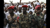 Members of the military stand as Gen. Mohammed Hamdan Dagalo, the deputy head of the military council, speaks during a military-backed tribe's rally, in the Nile River State, Sudan, Saturday, , on July 13, 2019. . (AP Photo/Mahmoud Hjaj)
