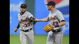 Detroit Tigers' Harold Castro, left, is congratulated by Gordon Beckham after turning a double play during the fifth inning of the team's baseball game against the Cleveland Indians, Wednesday, July 17, 2019, in Cleveland. (AP Photo/David Dermer)