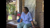 """Deloris Knight of Detroit, Mich., sits on her front porch, Wednesday, July 17, 2019, as she prepares for the heat wave that will descend upon Detroit and a wide section of the Midwest. Knight said she will keep the heat out of her Eastside Detroit home by keeping her doors and curtains closed while running the small window air conditioner in the living room. """"We have a couple of big fans. We have ceiling fans,"""" Knight, 63, said while enjoying Wednesday's more comfortable 80-plus degree weather from her front porch. (AP Photo Corey Williams)"""