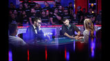 Hossein Ensan, of Germany; Dario Sammartino, of Italy; and Alex Livingston, from left, play at the final table of the World Series of Poker main event Tuesday, July 16, 2019, in Las Vegas. (AP Photo/John Locher)