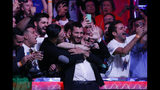 Dario Sammartino, of Italy, celebrates with fans after he eliminated Alex Livingston at the final table of the World Series of Poker main event Tuesday, July 16, 2019, in Las Vegas. (AP Photo/John Locher)