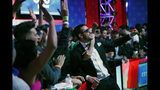 Dario Sammartino, of Italy, celebrates with supporters at the final table of the World Series of Poker main event, Tuesday, July 16, 2019, in Las Vegas. (AP Photo/John Locher)