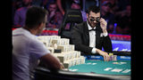 Dario Sammartino, right, of Italy, looks at Hossein Ensan, of Germany, as they play a hand at the final table of the World Series of Poker main event, Tuesday, July 16, 2019, in Las Vegas. (AP Photo/John Locher)