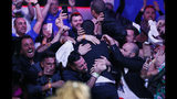 Dario Sammartino, of Italy, celebrates with supporters after going all-in and winning the hand at the final table of the World Series of Poker main event, Tuesday, July 16, 2019, in Las Vegas. (AP Photo/John Locher)