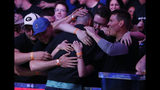 Fans embrace Alex Livingston after he was eliminated at the final table of the World Series of Poker main event, Tuesday, July 16, 2019, in Las Vegas. (AP Photo/John Locher)