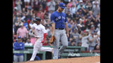 Toronto Blue Jays starting pitcher Thomas Pannone, right, walks back to the mound after giving up a three-run home run to Boston Red Sox's Rafael Devers, left, during the fifth inning of a baseball game against the Toronto Blue Jays at Fenway Park in Boston, Thursday, July 18, 2019. (AP Photo/Charles Krupa)