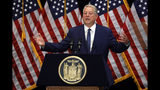 Former Vice President Al Gore delivers his remarks before witnessing New York Gov. Andrew Cuomo sign the Climate Leadership and Community Protection Act, Thursday, July 18, 2019, at Fordham University in New York. New York's new law aimed at ending climate change emissions will drive dramatic changes over the next 30 years if it meets its ambitious goals. (AP Photo/Richard Drew)