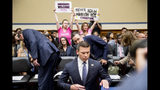 "Activists with Code Pink hold up signs that read ""Immigrants Welcome"" and ""Never Again Abolish ICE"" as Acting Secretary of Homeland Security Kevin McAleenan arrives to testify before a House Committee on Oversight and Reform hearing on Capitol Hill in Washington, Thursday, July 18, 2019. (AP Photo/Andrew Harnik)"