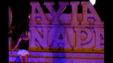 """A tourist walks at a sculpture that read """"I Love Ayia Napa"""" after pose for photos in the southeast resort of Ayia Napa in the easter Mediterranean island of Cyprus late Wednesday, July 17, 2019. A Cyprus police official says 12 Israelis have been detained after a 19-year-old British woman alleged that she was raped in the resort town of Ayia Napa. (AP Photo/Petros Karadjias)"""
