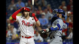 Philadelphia Phillies' Bryce Harper, left, reacts after striking out against Los Angeles Dodgers relief pitcher Julio Urias during the fourth inning of a baseball game Wednesday, July 17, 2019, in Philadelphia. At right is catcher Russell Martin. (AP Photo/Matt Slocum)