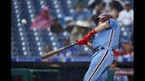 Philadelphia Phillies' J.T. Realmuto hits an RBI-sacrifice fly off Los Angeles Dodgers starting pitcher Ross Stripling during the third inning of a baseball game, Thursday, July 18, 2019, in Philadelphia. (AP Photo/Matt Slocum)