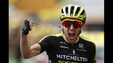 Britain's Simon Yates celebrates as he crosses the finish line to win the twelfth stage of the Tour de France cycling race over 209,5 kilometers (130 miles) with start in Toulouse and finish in Bagneres-de-Bigorre, France, Thursday, July 18, 2019. (AP Photo/ Thibault Camus)