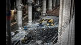 Excavator are pictured during preliminary work at the Notre-Dame de Paris Cathedral, Wednesday, July 17, 2019 in Paris. The chief architect of France's historic monuments says that three months after the April 15 fire that devastated Notre Dame Cathedral the site is still being secured. (Stephane de Sakutin/Pool via AP)