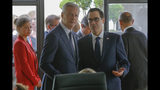 French Finance Minister Bruno Le Maire, left, talks to US Treasury Secretary Steve Mnuchin during a meeting at the G-7 Finance in Chantilly, north of Paris, on Thursday, July 18, 2019. (AP Photo/Michel Euler)