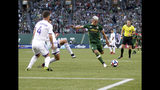 Portland Timbers' Brian Fernandez attempts a shot on goal as Orlando City players, including Will Johnson (4), defend during an MLS soccer match Thursday, July 18, 2019, in Portland, Ore. (Sean Meagher/The Oregonian via AP)