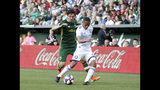 Portland Timbers' Zarek Valentin, left, and Orlando City's Robinho vie for control of the ball during the first half of an MLS soccer game Thursday, July 18, 2019, in Portland, Ore. (Sean Meagher/The Oregonian via AP)