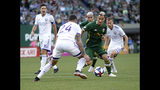 Portland Timbers' Sebastian Blanco navigates through Orlando City defense, including Kyle Smith (24), during the first half of an MLS soccer game Thursday, July 18, 2019, in Portland, Ore. (Sean Meagher/The Oregonian via AP)