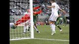 Orlando City keeper Greg Ranjitsingh makes a save next to teammate Dillon Powers, right, during the first half of an MLS soccer game against the Portland Timbers on Thursday, July 18, 2019, in Portland, Ore. (Sean Meagher/The Oregonian via AP)