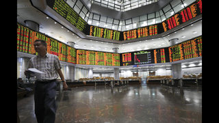 Global stocks mostly slide on trade war fears