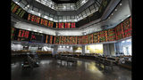 Investors sit in front of stock trading boards at a private stock market gallery in Kuala Lumpur, Malaysia, Thursday, July 18, 2019. Asian stock markets on Thursday followed Wall Street lower after President Donald Trump reignited trade fears by saying he could impose more tariffs on Chinese imports. (AP Photo/Vincent Thian)