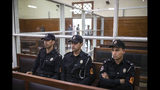 Security forces sit inside a court room before the start of a final trial session for suspects charged in connection with killing of two Scandinavian tourists in Morocco's Atlas Mountains, in Sale, near Rabat, Morocco, Thursday, July 18, 2019. The three main defendants in the brutal slaying of two female Scandinavian hikers have asked for forgiveness from Allah ahead of a verdict. (AP Photo/Mosa'ab Elshamy)