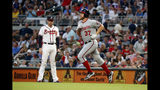 Washington Nationals starting pitcher Stephen Strasburg (37) runs past Atlanta Braves first baseman Freddie Freeman (5) as he runs the bases after hitting a two-run home run during the third inning of a baseball game Thursday, July 18, 2019, in Atlanta. (AP Photo/John Bazemore)