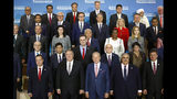 Secretary of State Mike Pompeo, second from bottom left, and heads of delegations to the Ministerial to Advance Religious Freedom pose for a family photo, Thursday, July 18, 2019, at the U.S. State Department in Washington. (AP Photo/Patrick Semansky)