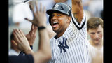 New York Yankees' Aaron Hicks celebrates with teammates after hitting a solo home run in the sixth inning of the first game of a baseball doubleheader against the Tampa Bay Rays, Thursday, July 18, 2019, in New York. (AP Photo/Kathy Willens)
