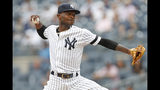New York Yankees' starting pitcher Domingo German winds up during the first inning in the first game of a baseball doubleheader, Thursday, July 18, 2019, in New York. (AP Photo/Kathy Willens)x