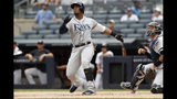 Tampa Bay Rays' Yandy Diaz, left, and New York Yankees' catcher Gary Sanchez watch Diaz's home run during the first inning of the first game of a baseball doubleheader, Thursday, July 18, 2019, in New York. (AP Photo/Kathy Willens)