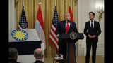 President Donald Trump speaks during a ceremony where Dutch Prime Minister Mark Rutte will present a 48-star flag flown on a U.S. Naval vessel during the D-Day invasion, in the East Room of the White House, Thursday, July 18, 2019, in Washington. The flag will be given to the Smithsonian's National Museum of American History. The vessel was control vessel Landing Craft, Control 60 (LCC 60). (AP Photo/Carolyn Kaster)