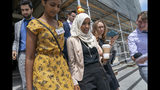 Rep. Ilhan Omar, D-Minn., a target of racist rhetoric from President Donald Trump, walks from the House to her office surrounded by reporters, at the Capitol in Washington, Thursday, July 18, 2019. (AP Photo/J. Scott Applewhite)