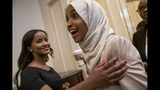 Rep. Ilhan Omar, D-Minn., a target of racist rhetoric from President Donald Trump, smiles as she is greeted at the Capitol following votes, in Washington, Thursday, July 18, 2019. (AP Photo/J. Scott Applewhite)