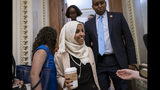 Rep. Ilhan Omar, D-Minn., a target of racist rhetoric from President Donald Trump, is joined at right by fellow freshman Rep. Joe Neguse, D-Colo., as she walks to her office following votes, at the Capitol in Washington, Thursday, July 18, 2019. (AP Photo/J. Scott Applewhite)