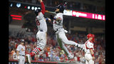 St. Louis Cardinals' Jose Martinez, right, and Harrison Bader (48) celebrate Martinez's three-run home run off Cincinnati Reds relief pitcher Jared Hughes during the sixth inning of a baseball game Friday, July 19, 2019, in Cincinnati. (AP Photo/Gary Landers)