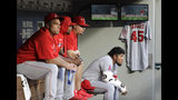 Los Angeles Angels pitcher Jaime Barria, right, sits in the dugout next to a jersey bearing the number of former Angels pitcher Tyler Skaggs, who died earlier this month, during the first inning of the team's baseball game against the Seattle Mariners, Friday, July 19, 2019, in Seattle. (AP Photo/Ted S. Warren)